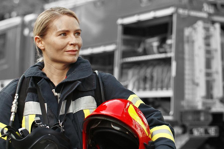 Firefighter standing near firetruck