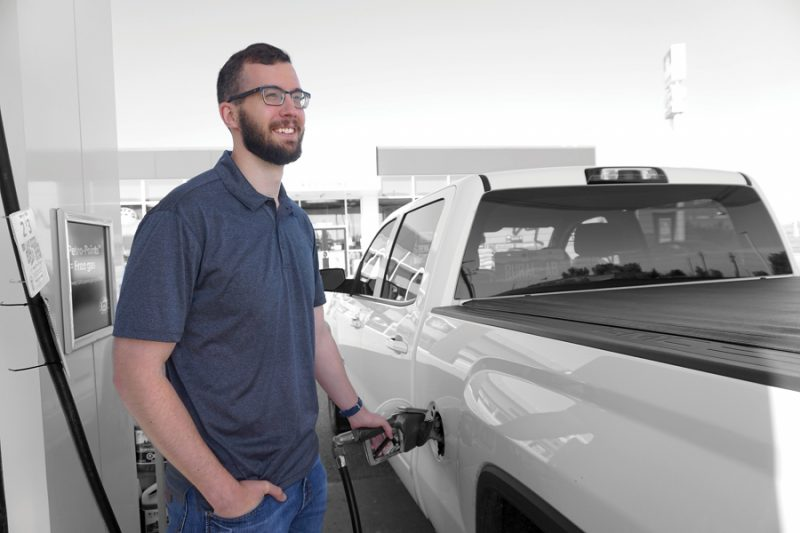 A man fills his truck with gasoline
