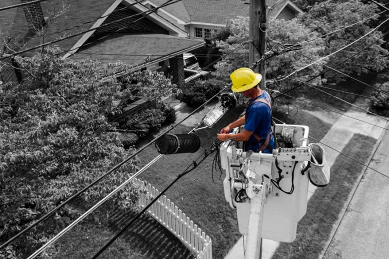 a man in a bucket fixes power lines