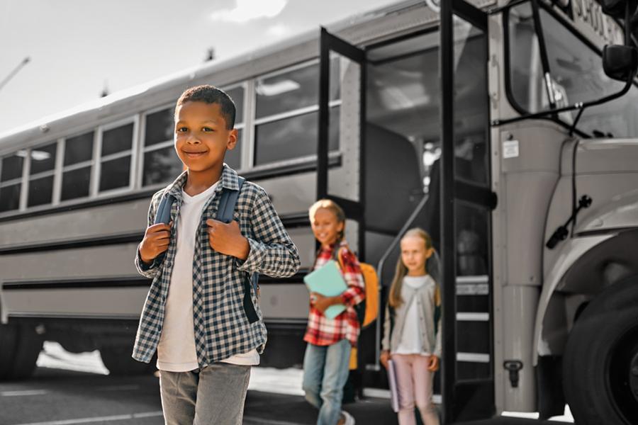 Children walking off a school bus