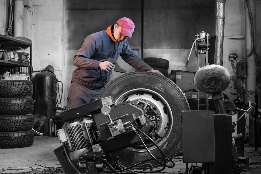 a man works over a large tire